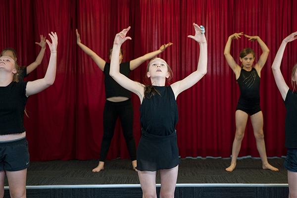 St Francis de Sales Catholic Primary School Woolooware Co-curricular Dance Students in black dance outfits performing