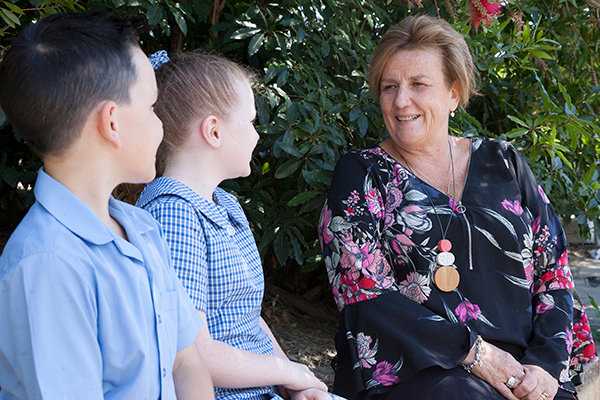 St Francis de Sales Catholic Primary School Principal's Message Principal talking with two students
