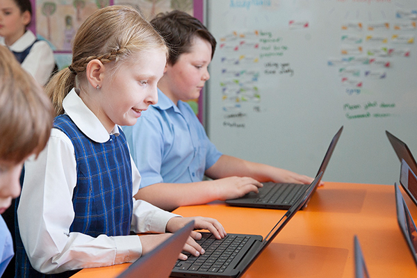 St Francis de Sales Catholic Primary School Students on laptops in modern classroom